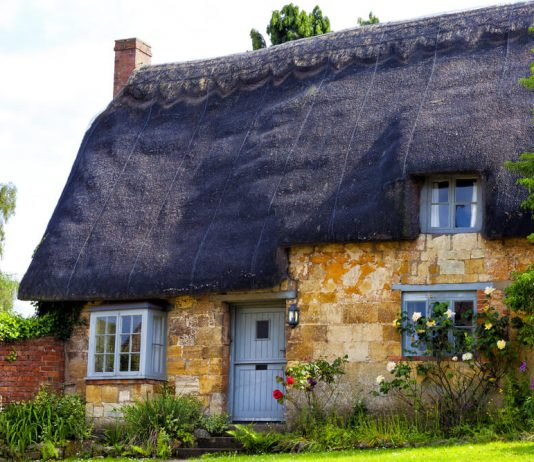 Traditional Old English Cottage with Thatched Roof