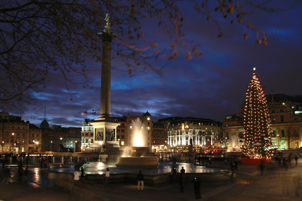 Trafalgar Square at night with Christmas Tree and Fountains